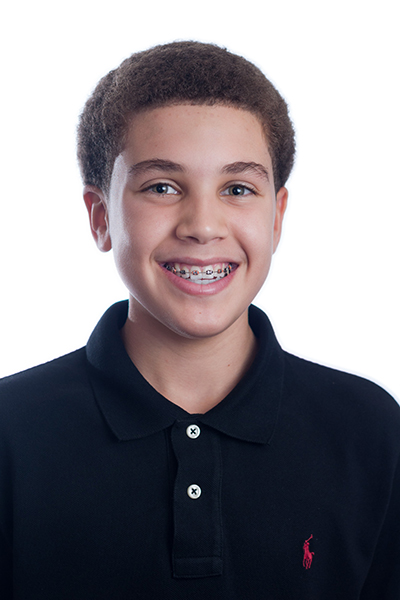 A young man smiling and showing off his braces