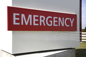 A red sign with white words on it saying emergency.
