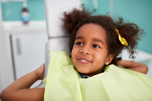 A child smiling after receiving a dental exam at Great Grins for KIDS - Oregon City in Oregon City, OR